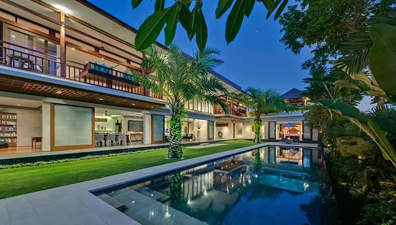 Pool And Villa At Dusk