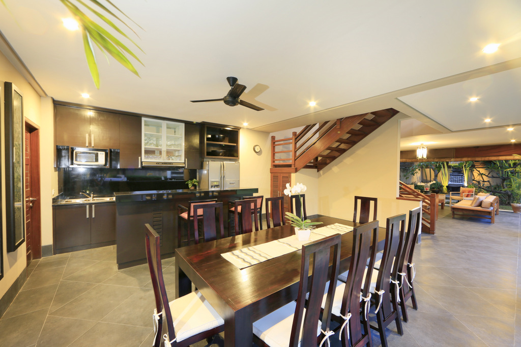 Dining_And_Living_Overlooking_Stairs_To_2nd_Floor