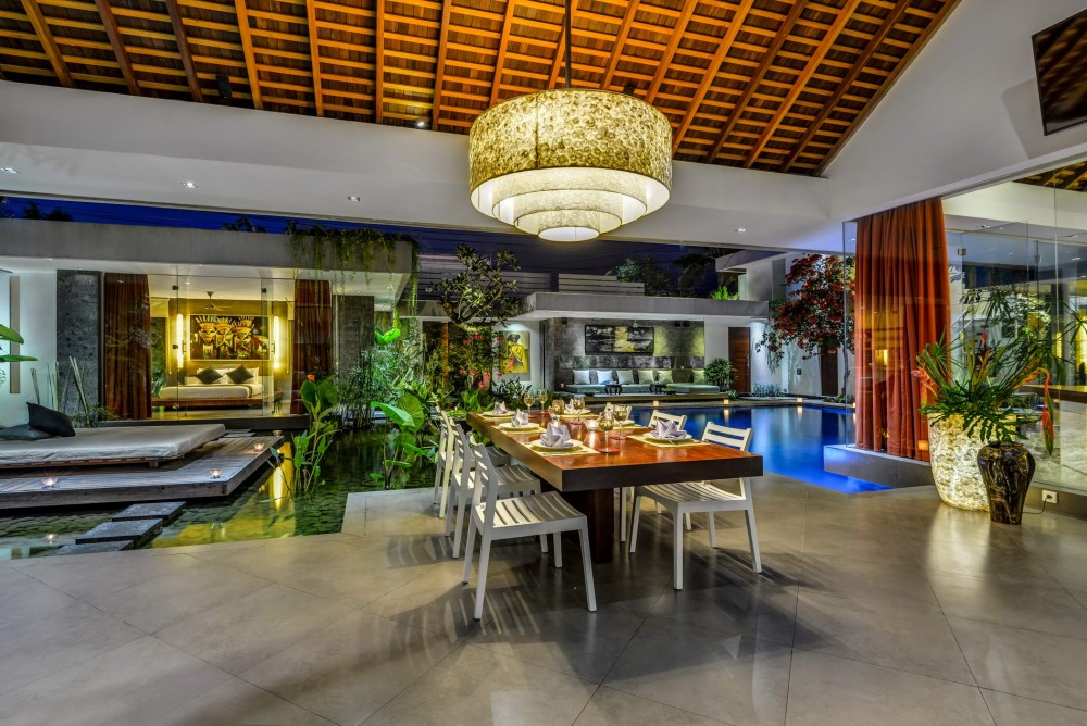 Open_Style_Dining_Area_View_To_Fish_Pond_And_Pool